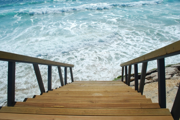 Wooden stairs or path to the bright ocean